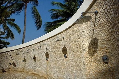 poolside showers with palm trees