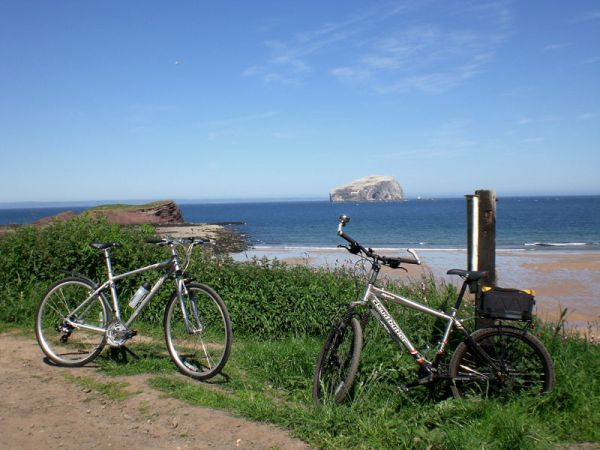 two bikes by the sea on a sunny day
